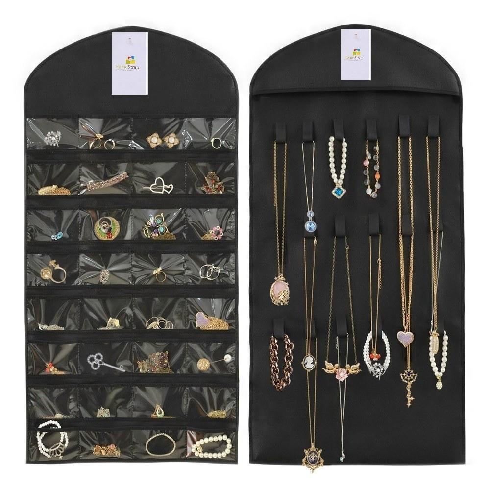 Earring and bracelets kept in the transparent pockets of the organiser. Neckpieces are hung up on the loops of the organiser.