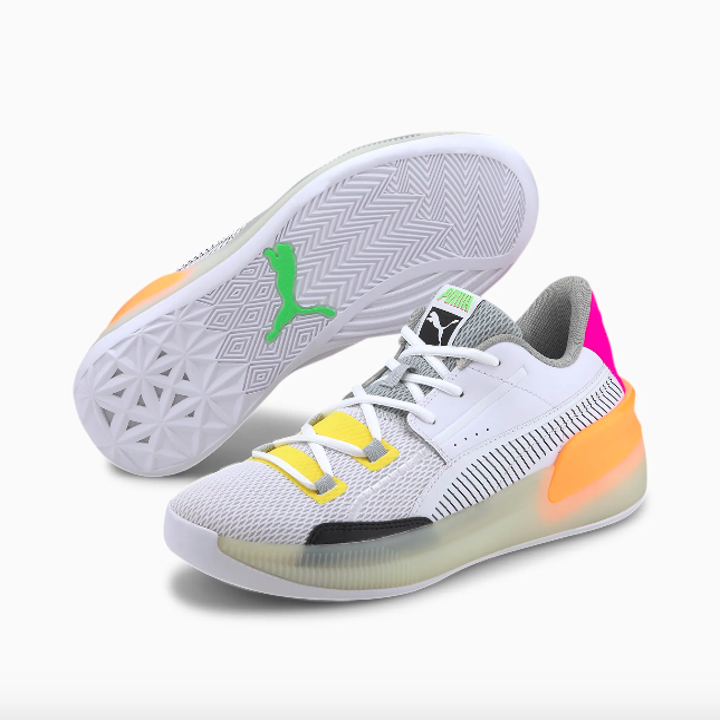 white retro style sneakers with neon accents