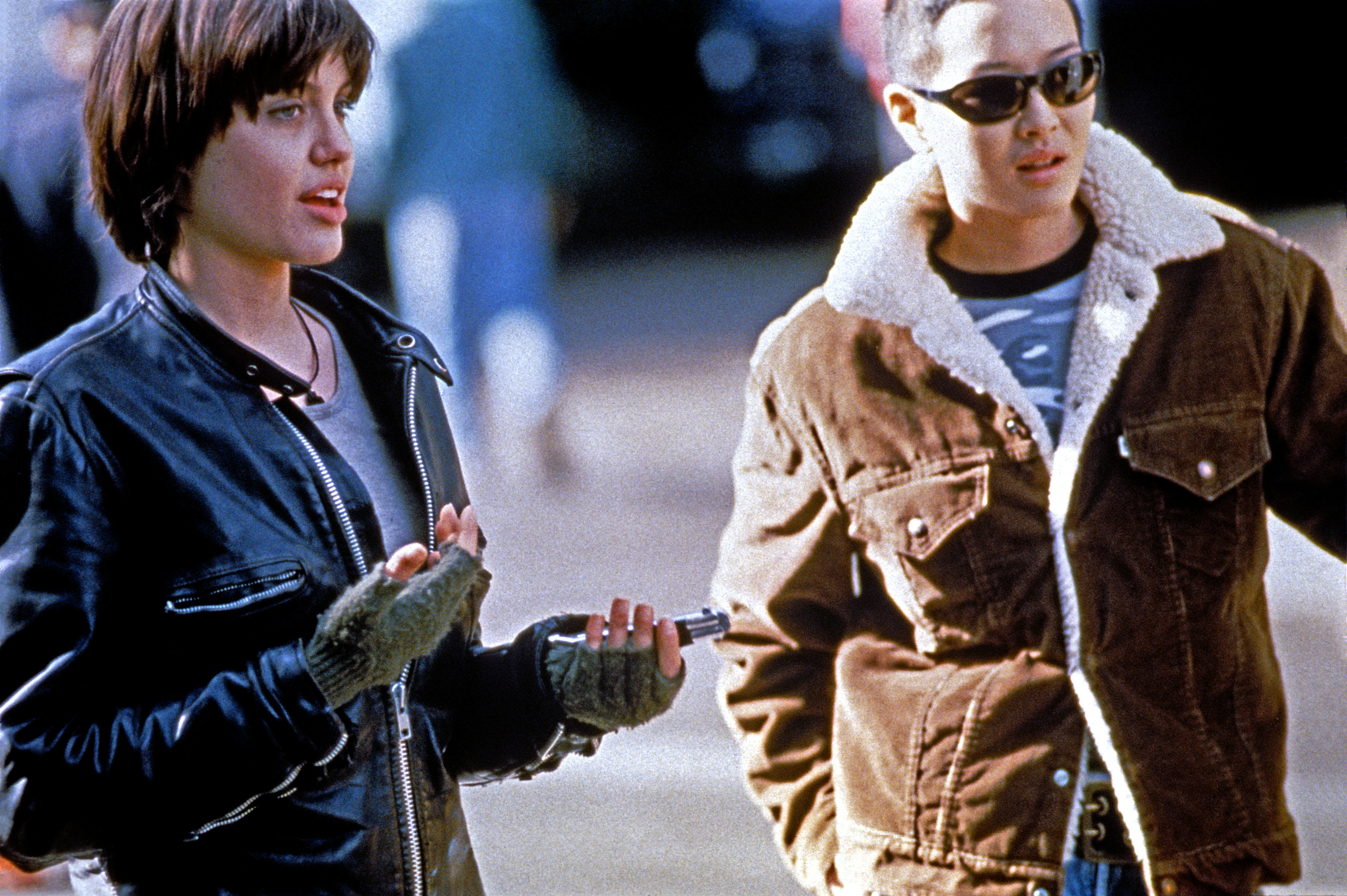 "Angelina Jolie and Jenny Shimizu as Legs and Rita in ""Foxfire"""