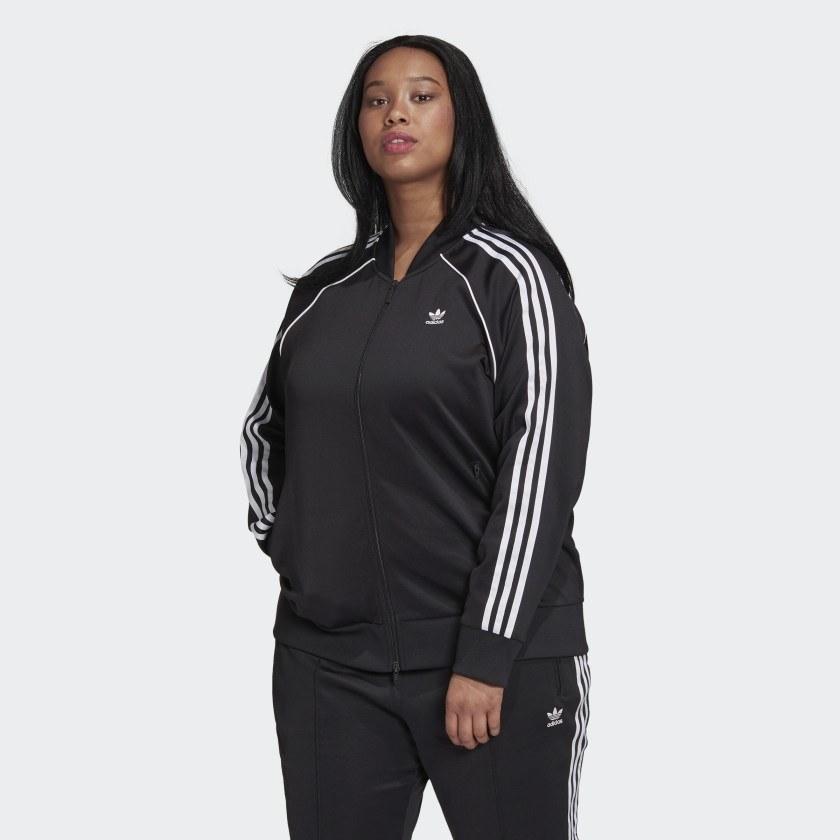Model wearing black and white style of jacket