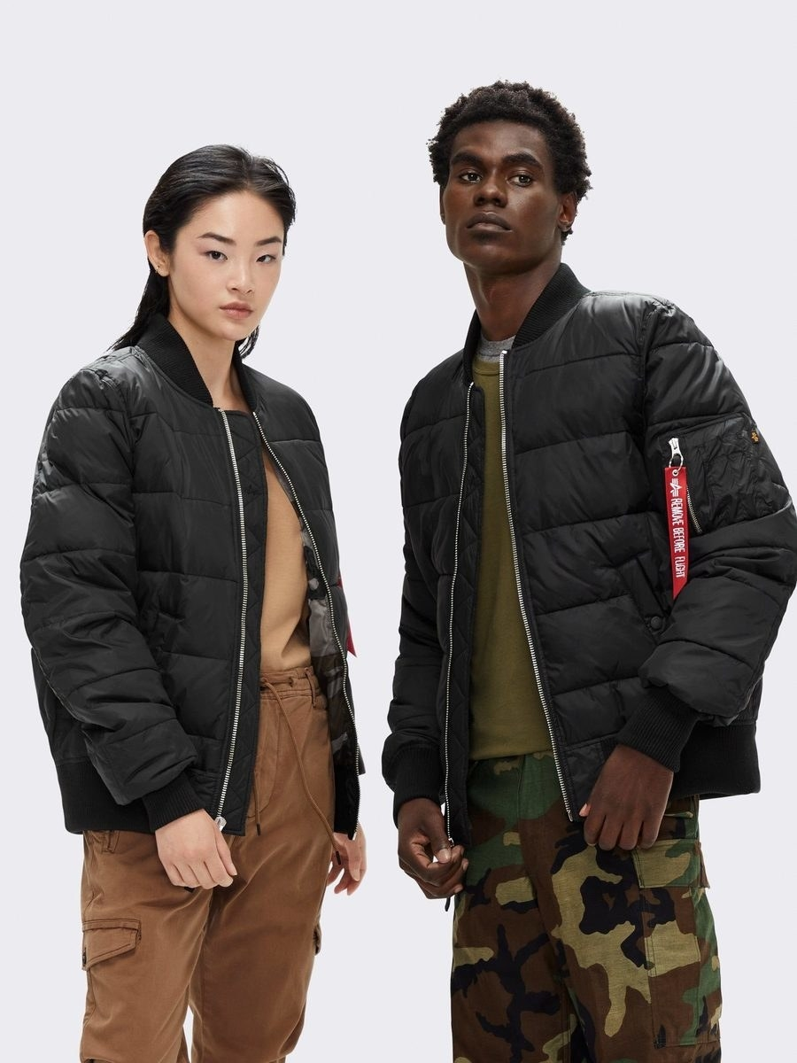 two models wear the unisex ma-1 echo ii bomber jacket