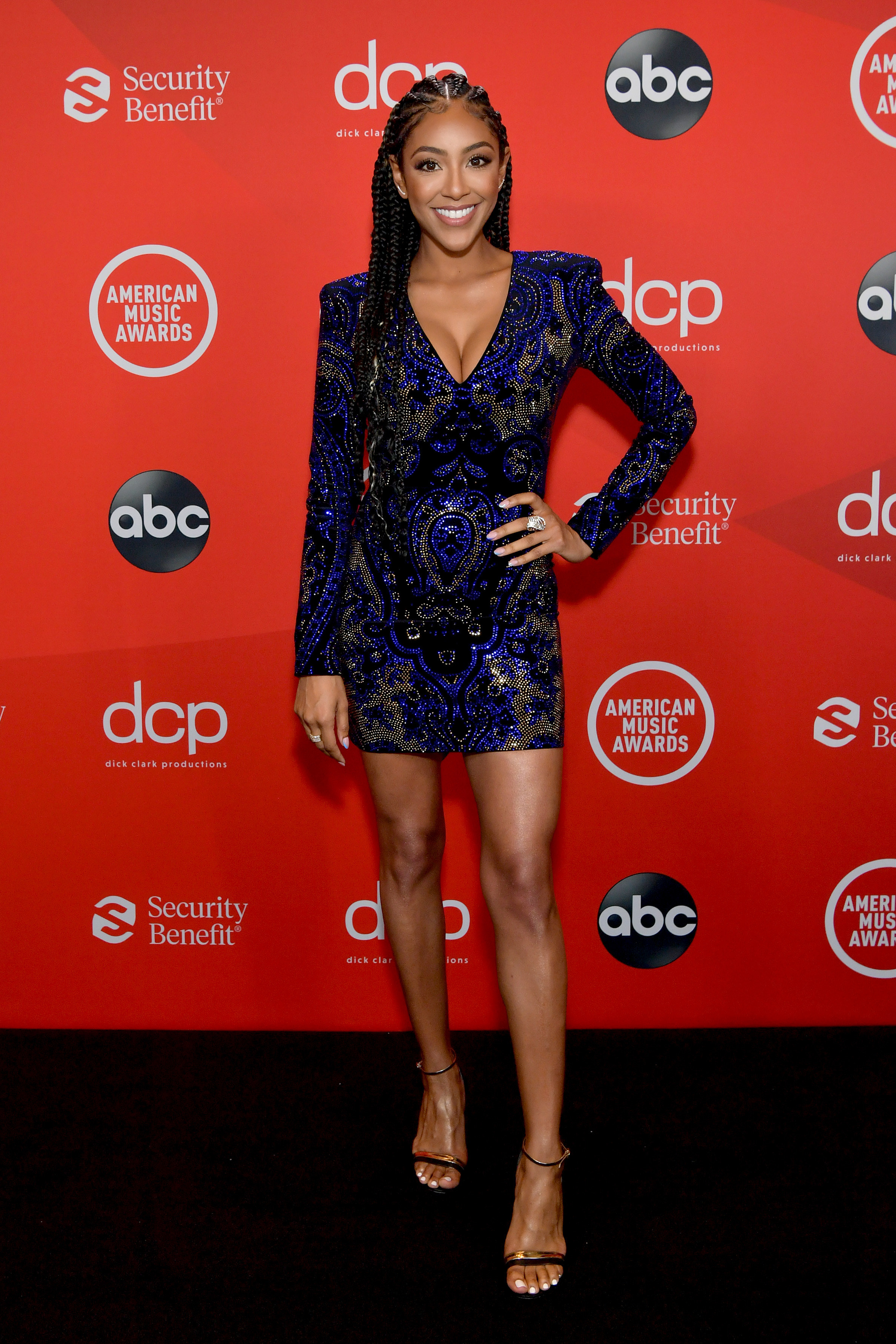 Tayshia Adams attends the 2020 American Music Awards in a short low-cut dress