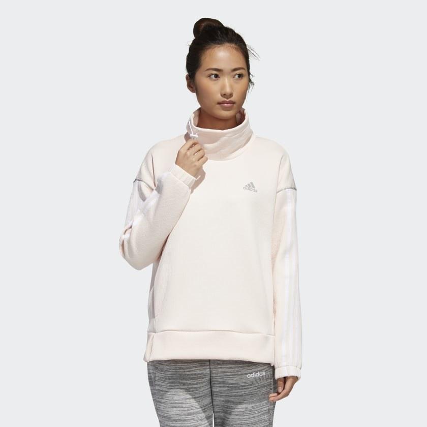 Model wearing cream-colored sweatshirt