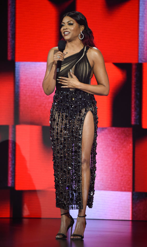2020 American Music Awards hosted by Taraji P. Henson in a one-shoulder dress with a sheer bottom