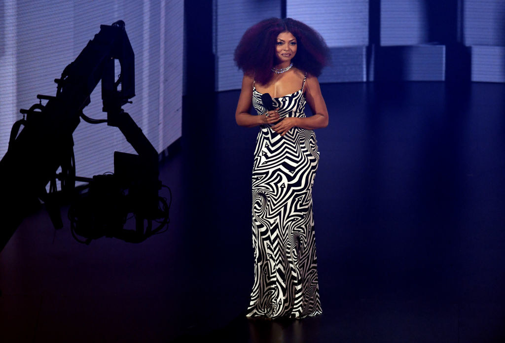 Taraji P. Henson speaks onstage for the 2020 American Music Awards in a printed dress
