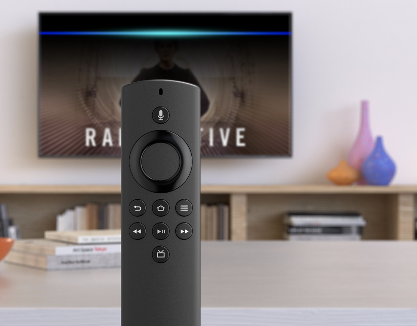 A small slim black remote with controls for the television