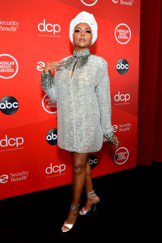 Taraji P. Henson attends the 2020 American Music Awards in a short bedazzled tunic and matching head wrap