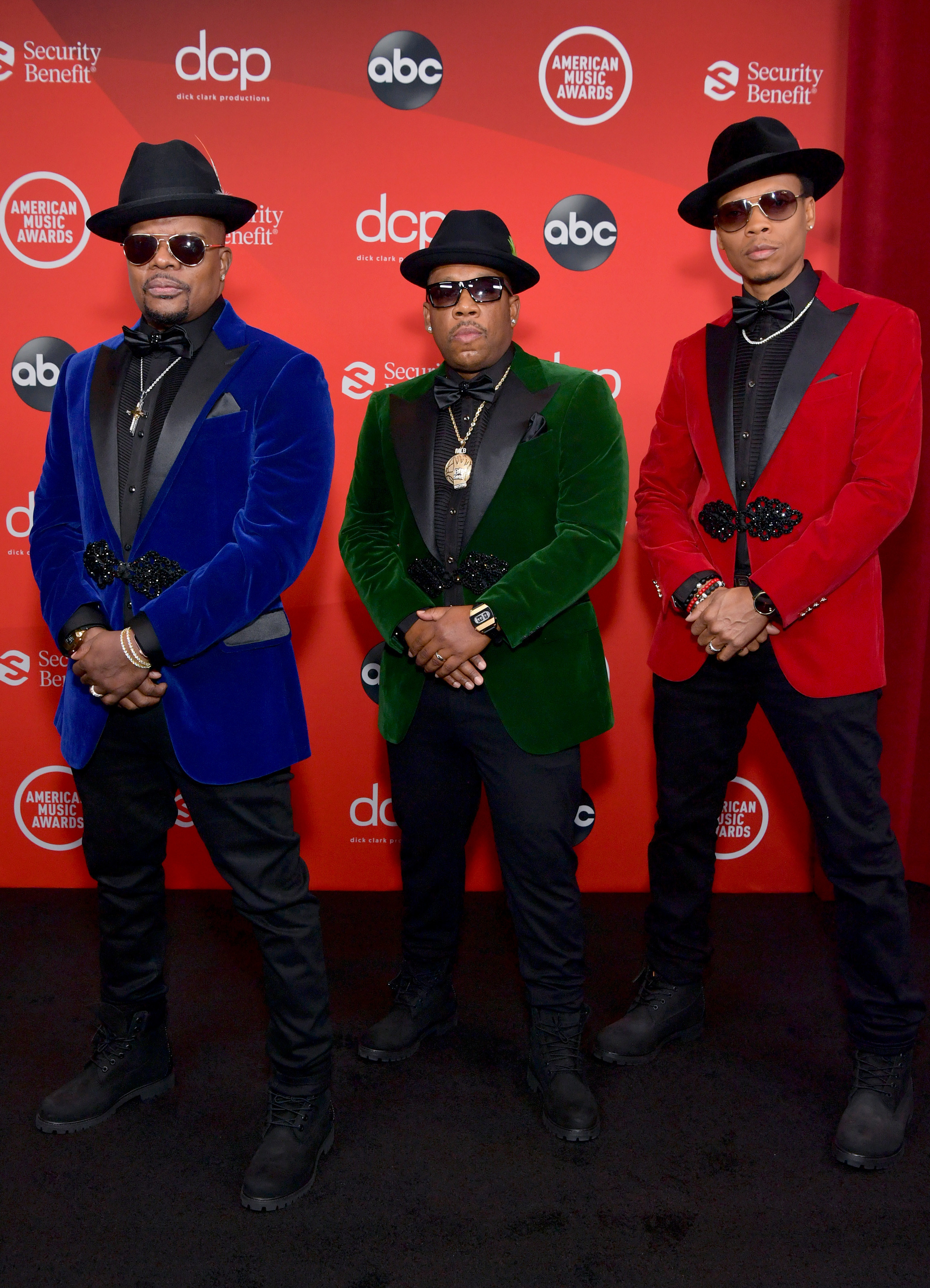 Ricky Bell, Michael Bivins, and Ronnie DeVoe of Bell Biv DeVoe attend the 2020 American Music Awards in coordinating suits