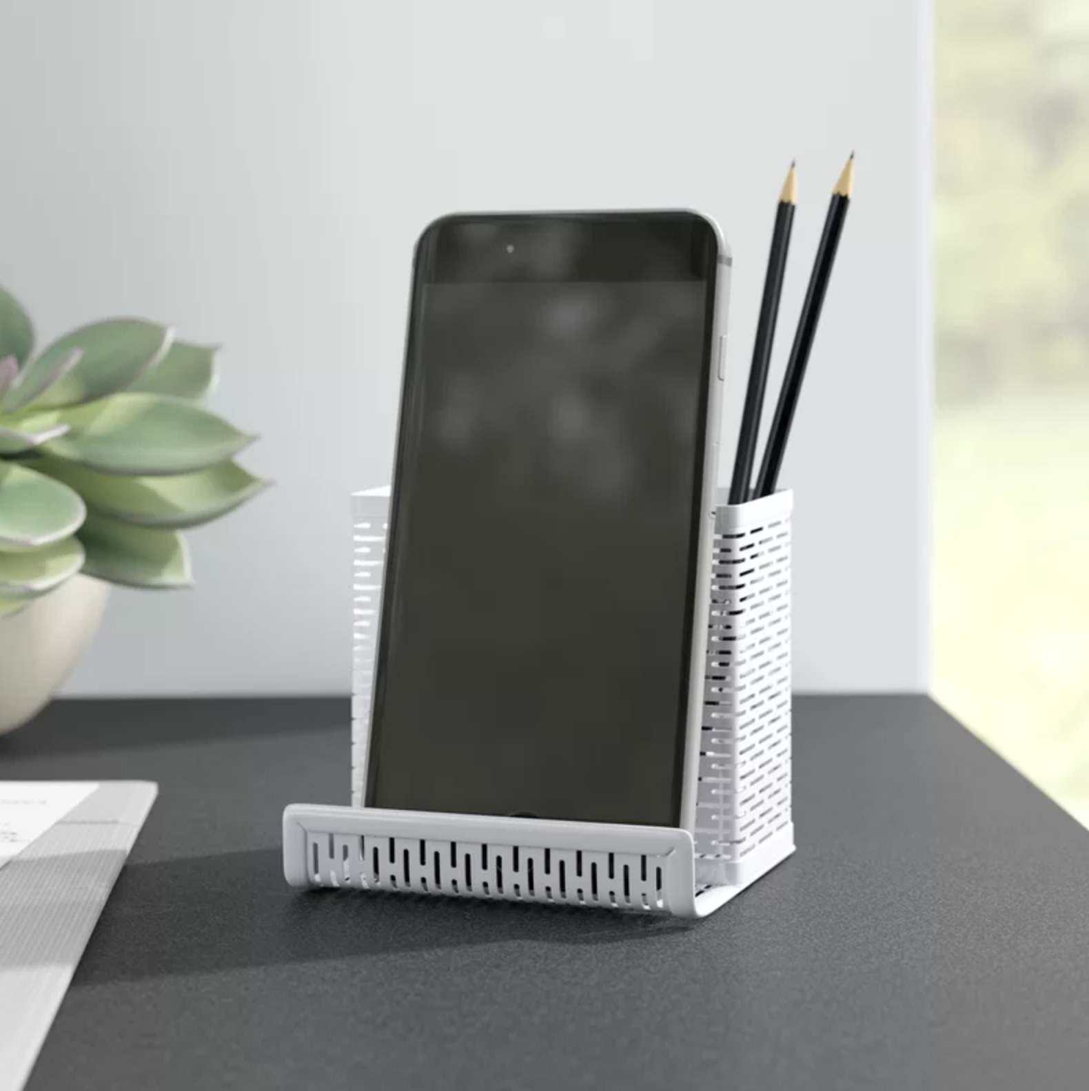 The metal pencil and phone holder