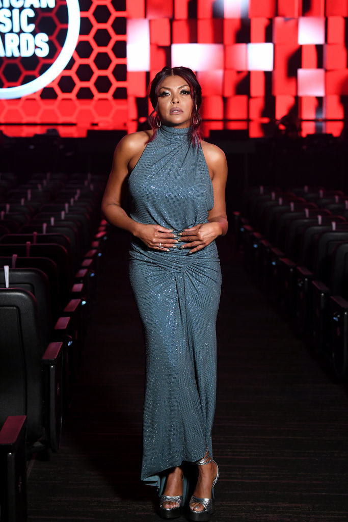 Taraji P. Henson poses onstage for the 2020 American Music Awards in a halter dress and her hair in an updo