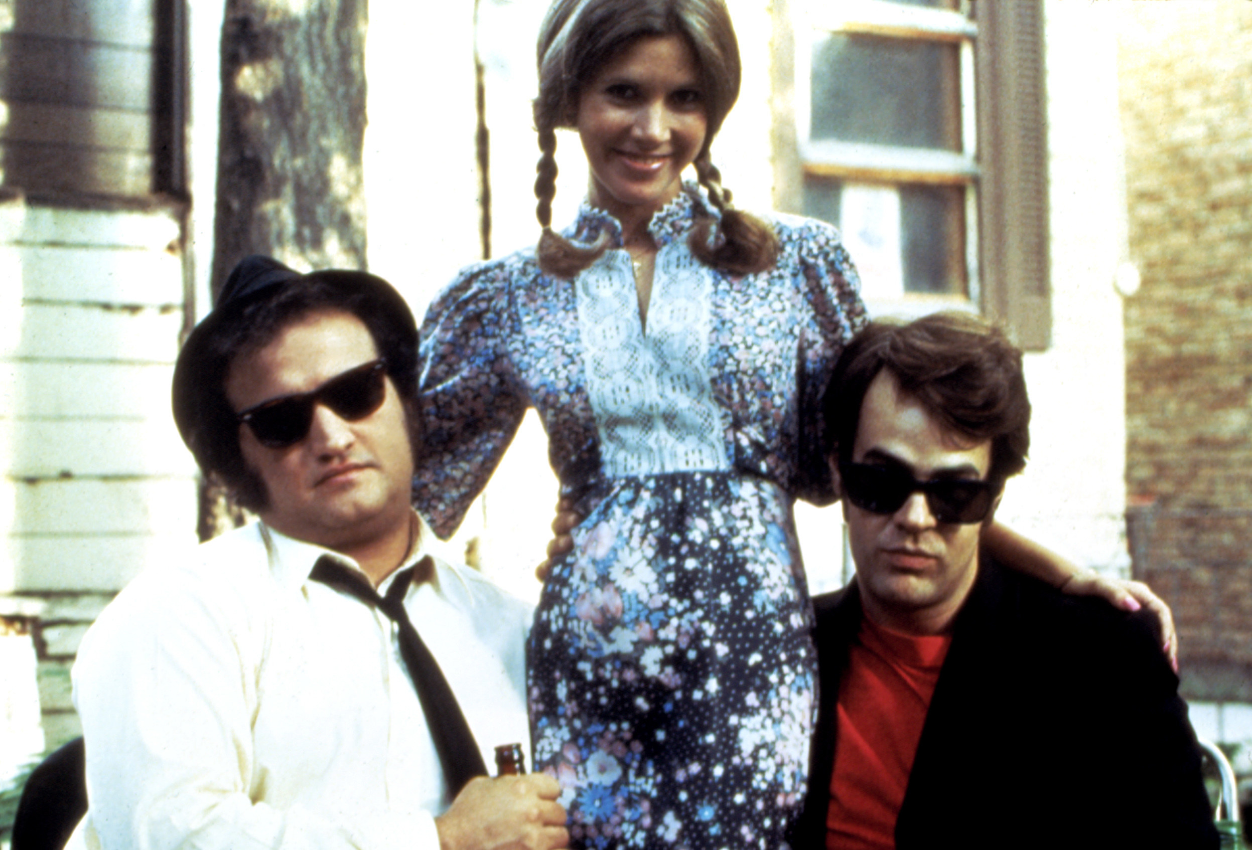 "John Belushi, Carrie Fisher, and Dan Aykroyd on set of ""The Blues Brothers"""