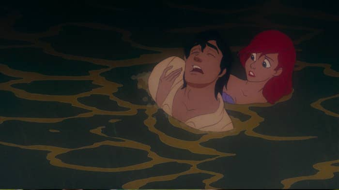 Ariel pulls Eric out of the water