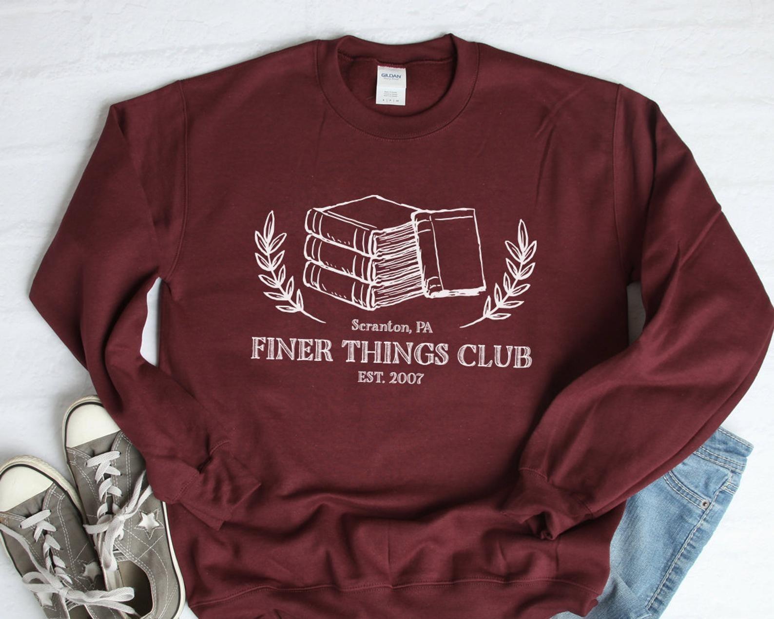 "sweatshirt that reads ""Finer Things Club est. 2007"""