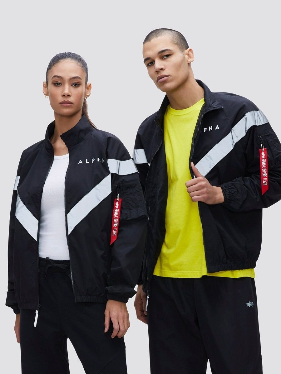 two models wear the pt track jacket in black