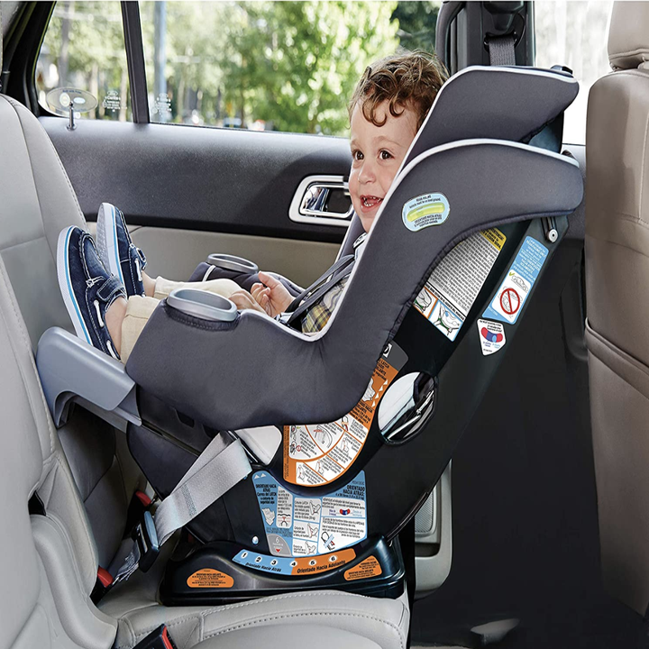 A child in the rear facing gray carseat