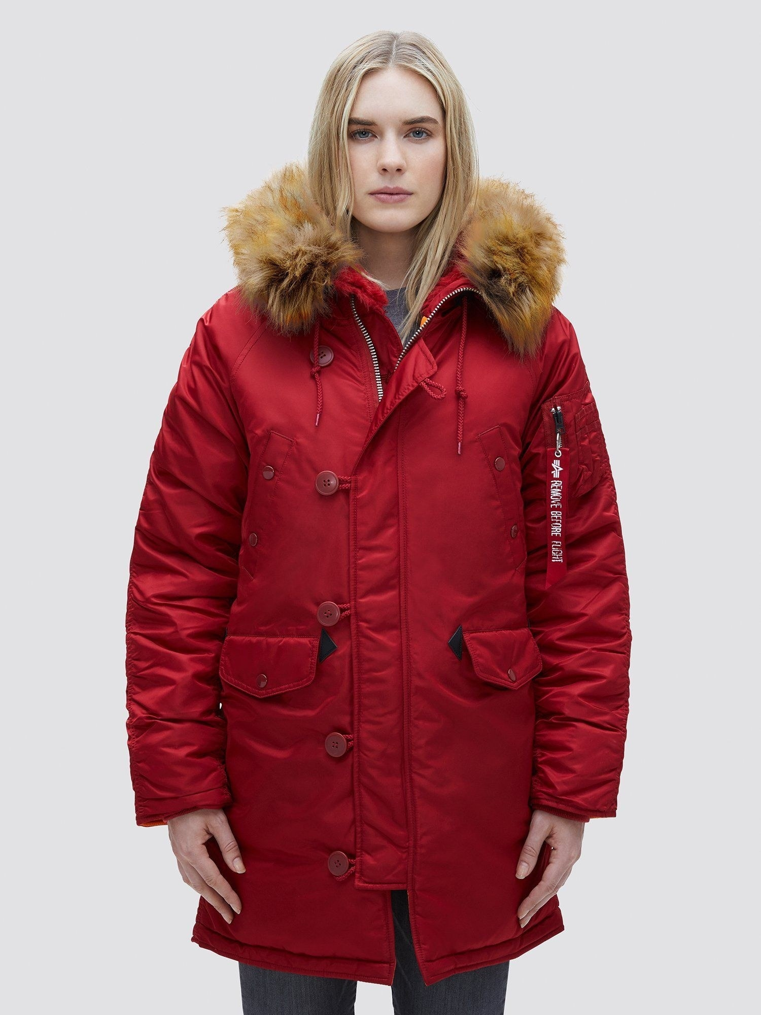 a model wears the n-3b w parka in commander red