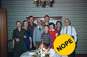 "Multi-generational family standing behind a thanksgiving table with ""Nope"" label photoshopped on top."