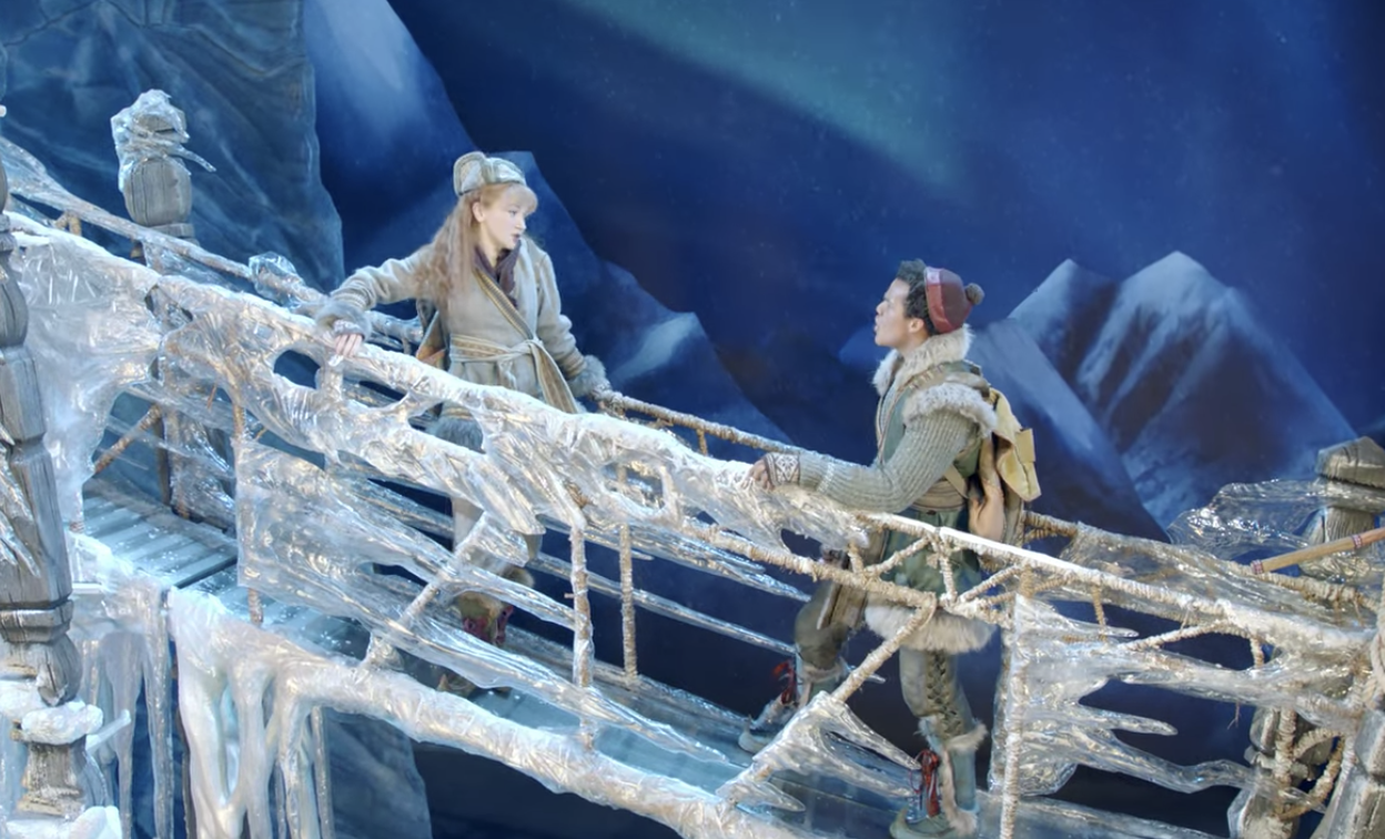 Anna and Kristoff talking on an ice bridge