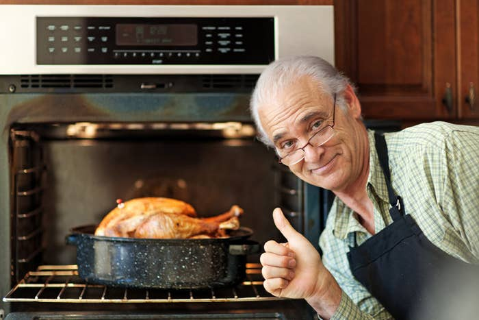 Proud single senior man cooking turkey