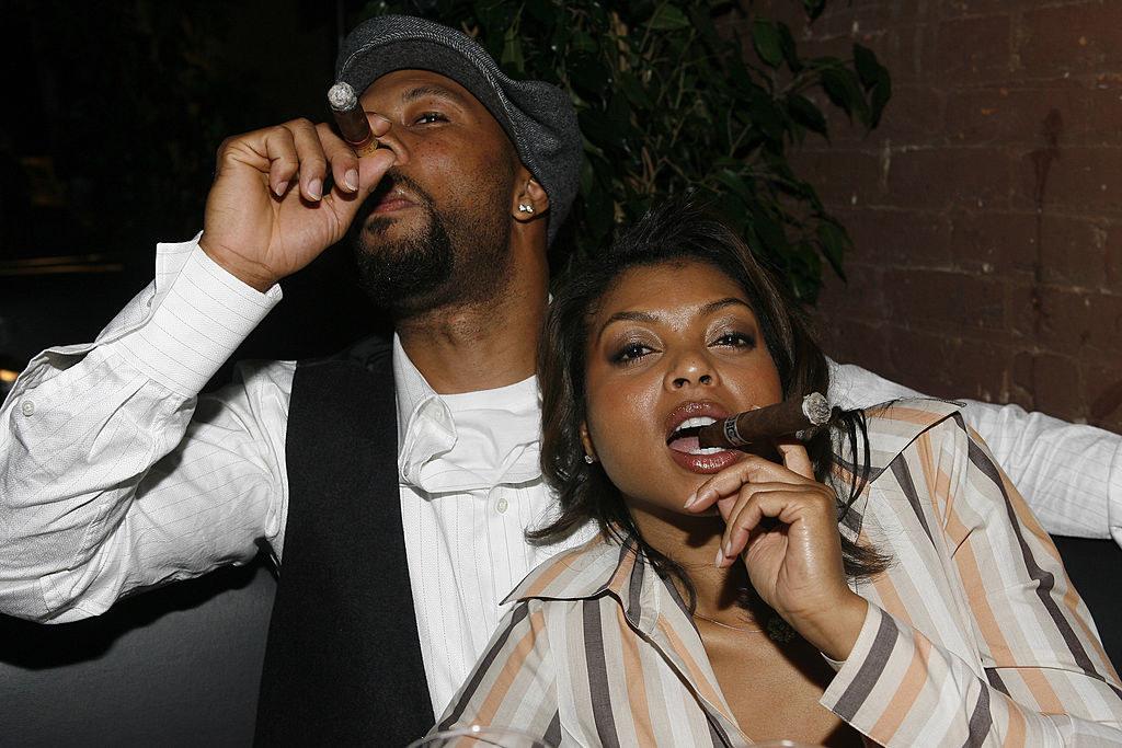 Common and Taraji P. Henson smoking cigars at a restaurant in LA