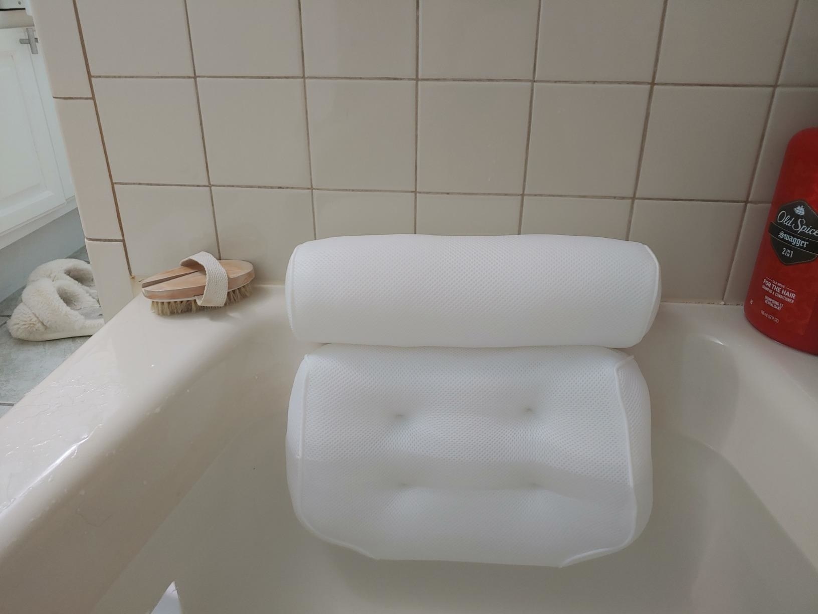 The pillow in a filled bathtub