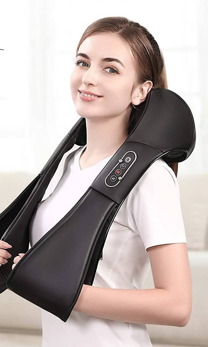 woman using the massager around her neck