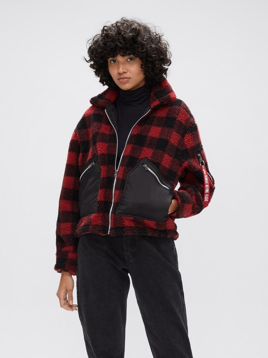 a model wears the cropped sherpa utility jacket in red plaid