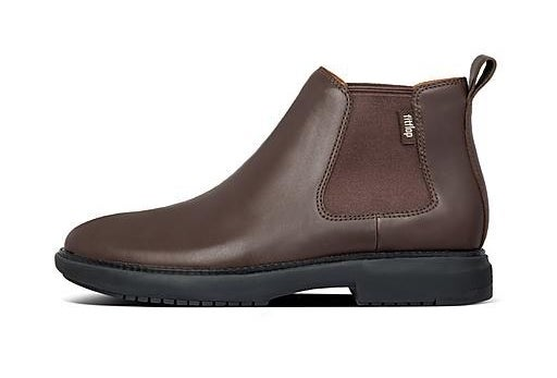 A profile view of a brown leather ankle boot with elasticized gores and a black outsole