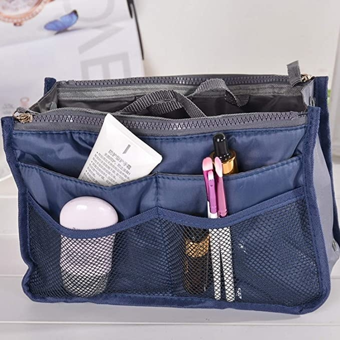 Blue and grey bag organiser with various mesh compartments.