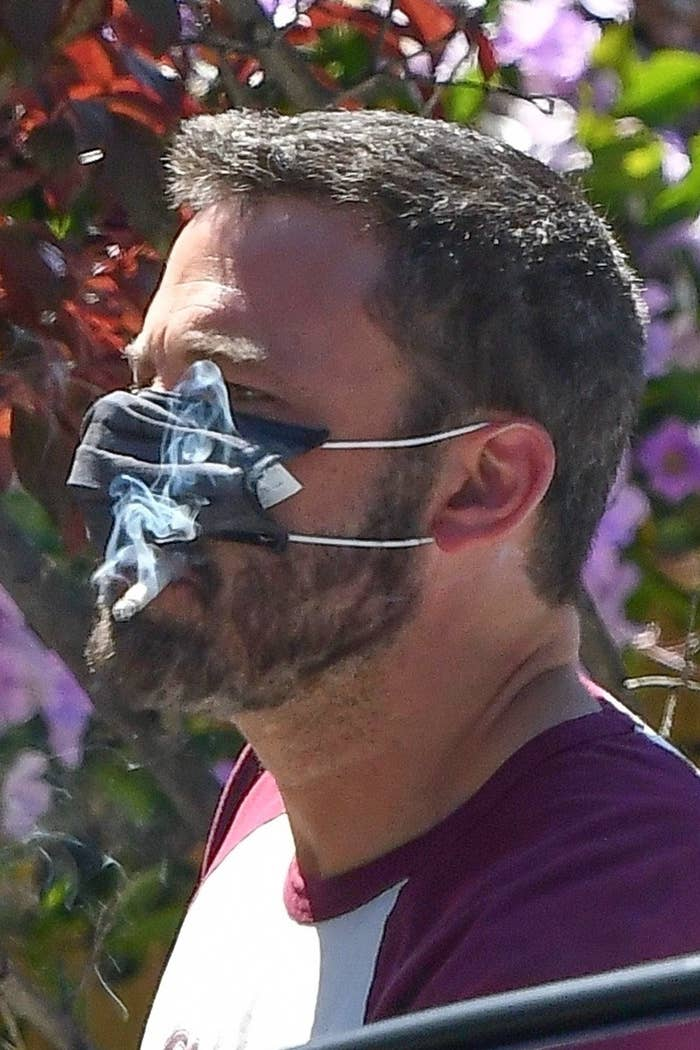 ben smoking a cig through his mask