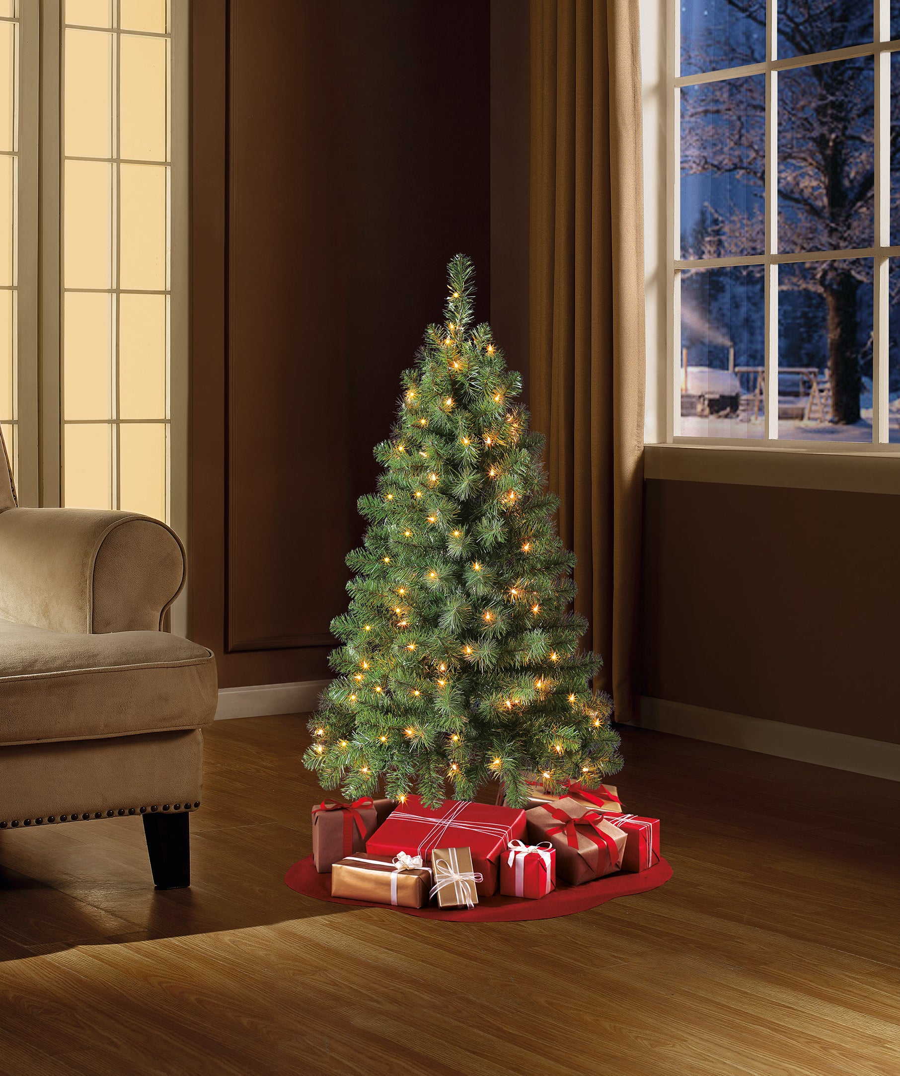The Christmas tree placed beside a couch to show scale and size