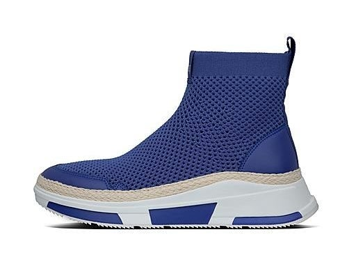 A profile view of a mesh high-top sneaker with no laces, jute trim along the outsole and a chunky white sole