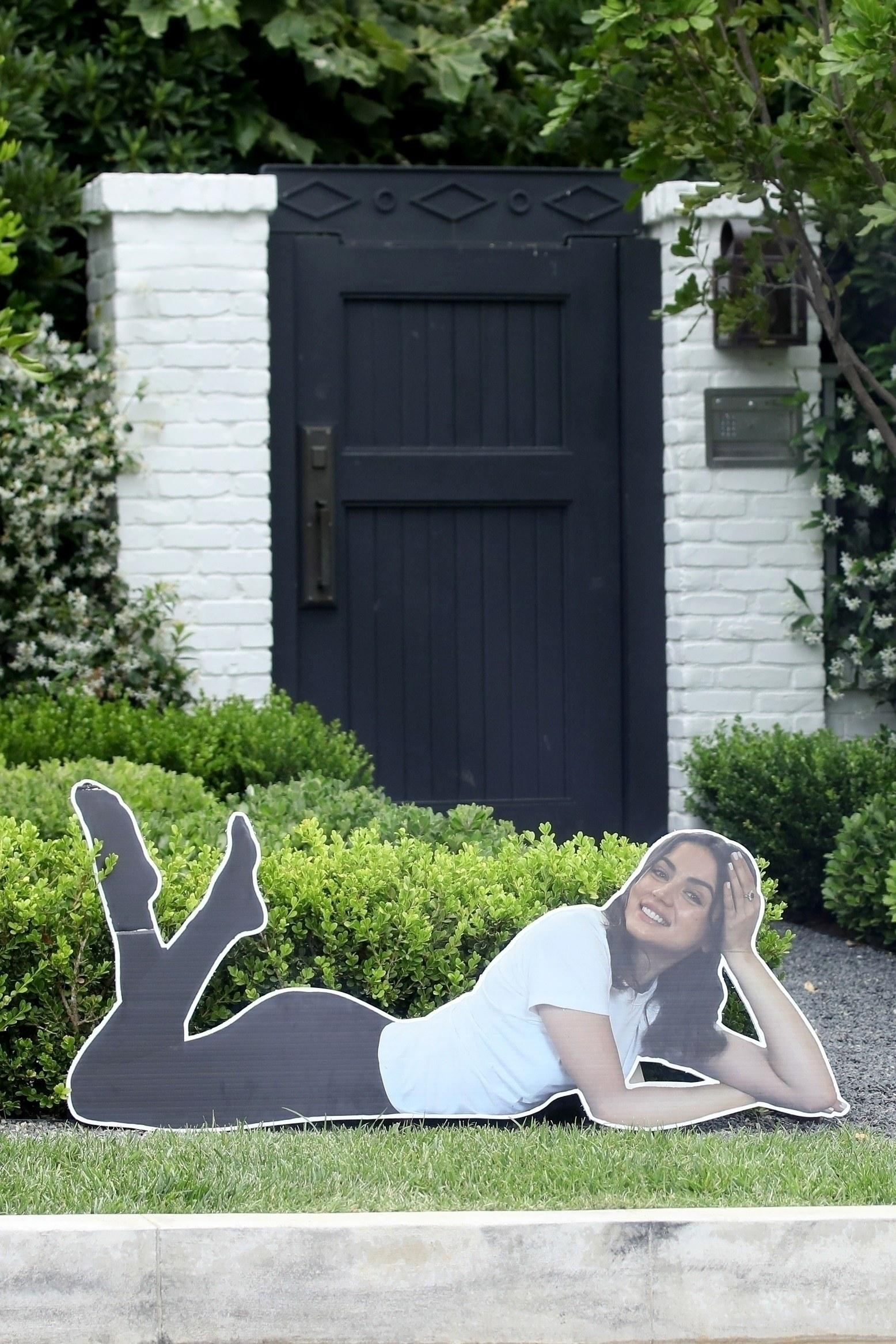 ana posing in cardboard form