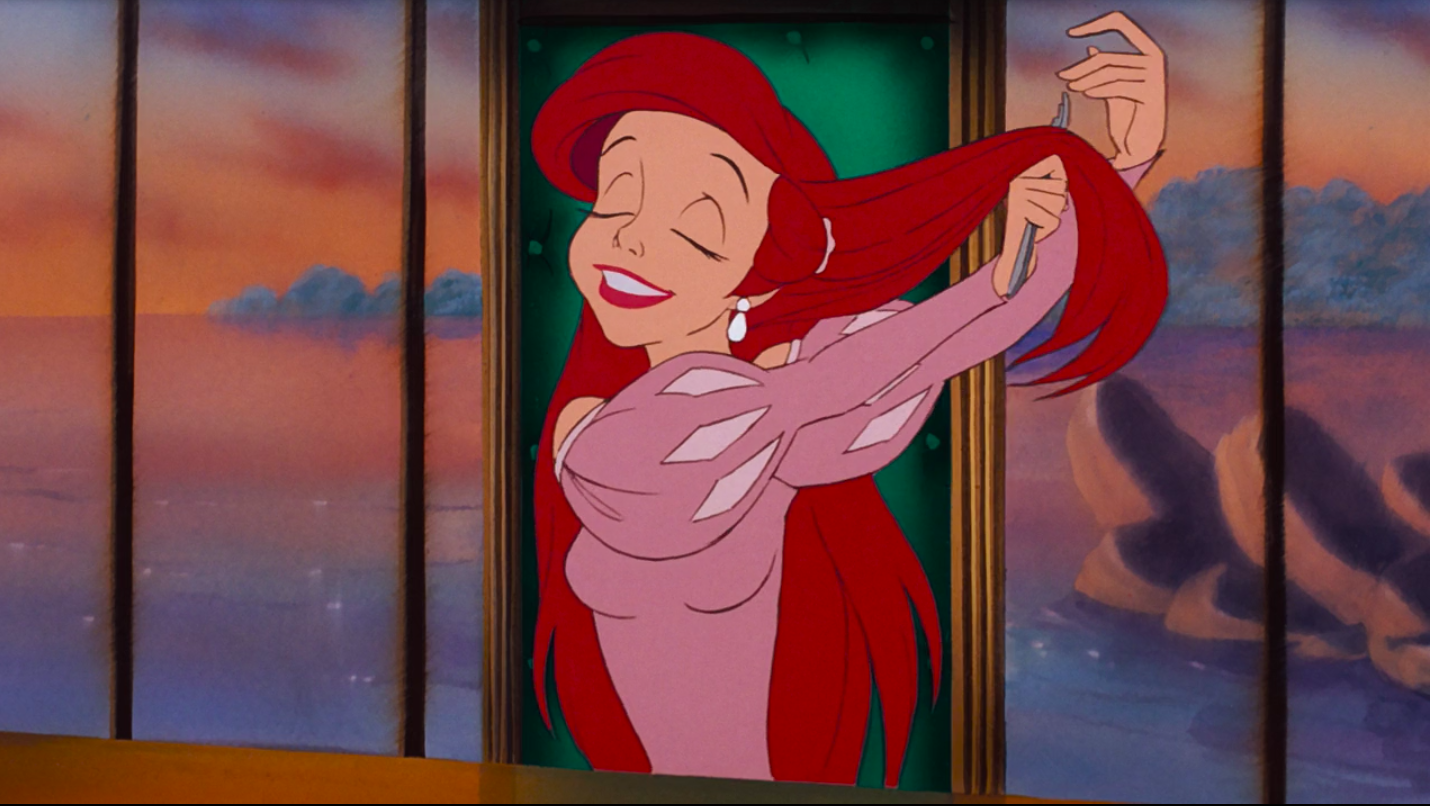 Ariel brushing her hair with a fork