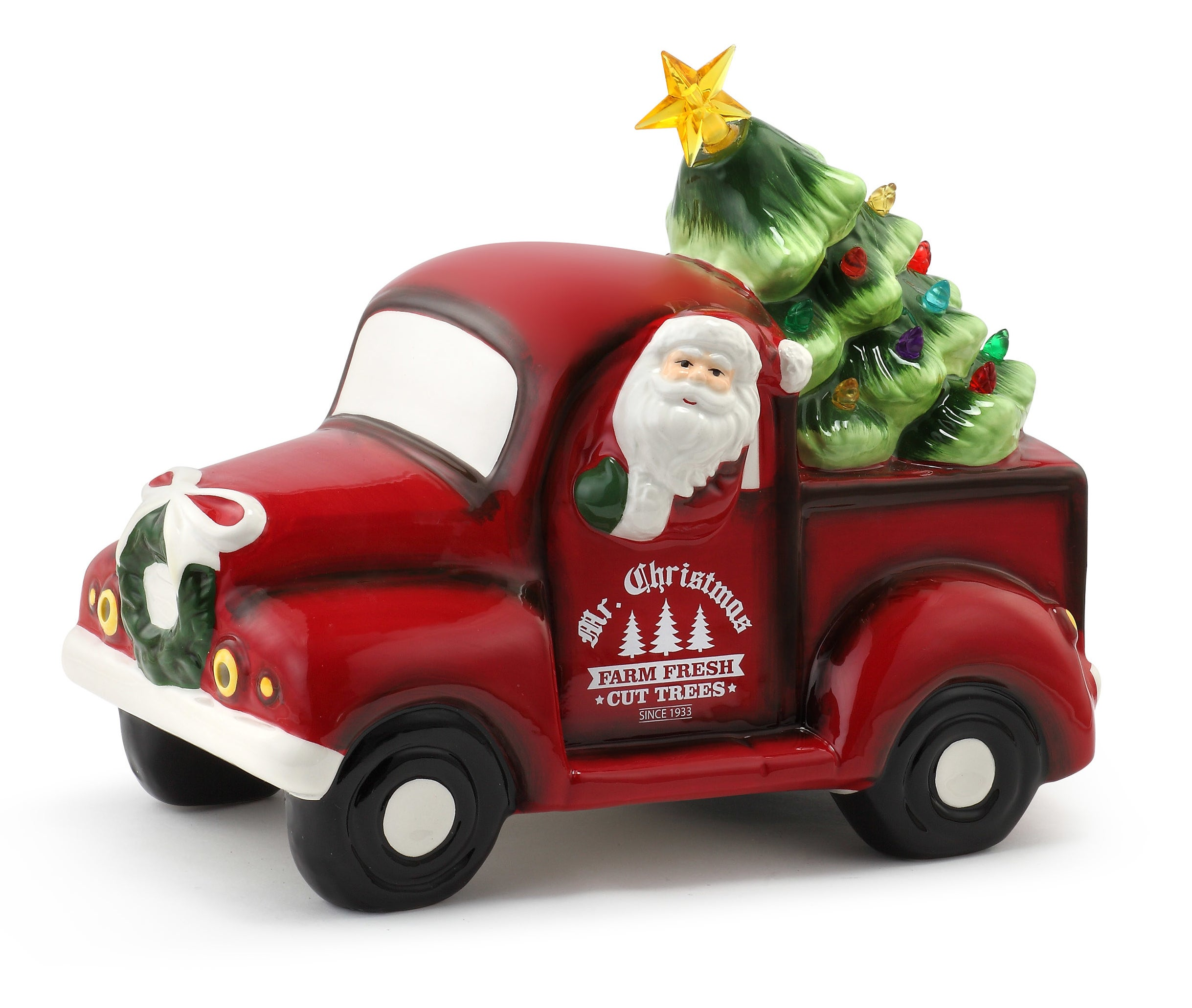 The Santa driving a truck figurine featuring a Christmas tree with LED lights turned on