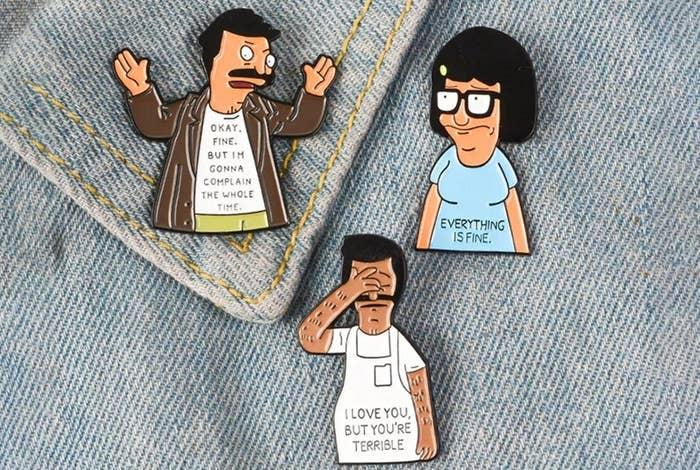 Tina and Bob pins on a jean jacket