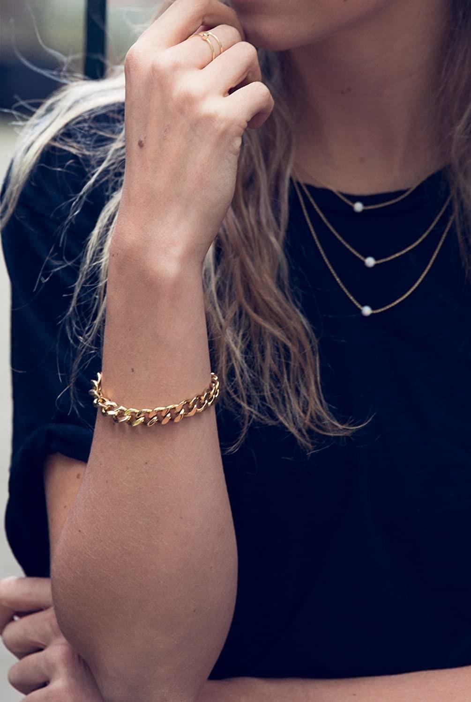 model wearing the gold chain bracelet