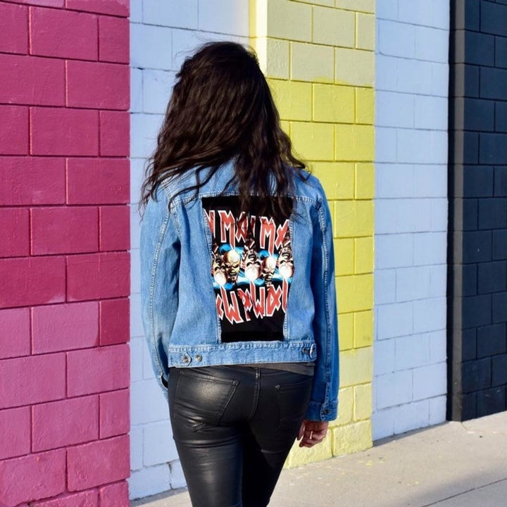 model wearing denim jacket with an Iron Maiden patch on the back