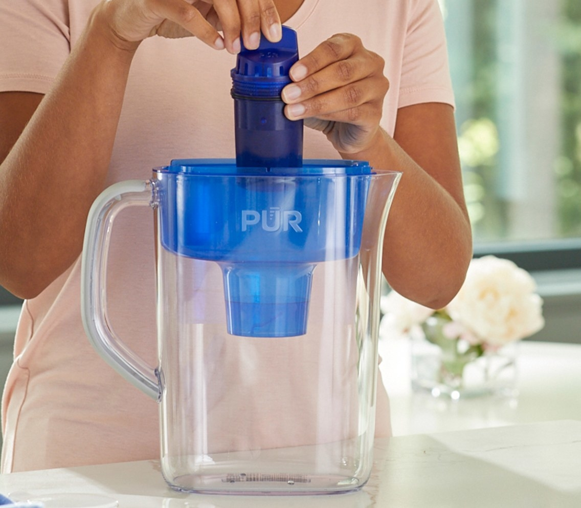 The basic water pitcher with a filter in clean and blue plastic