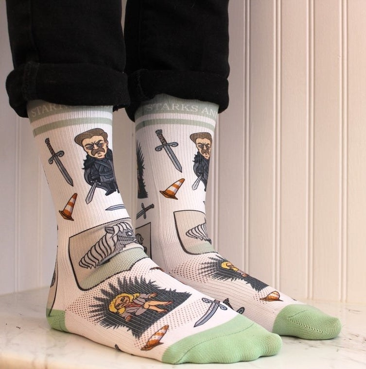 A person wearing the socks with rolled up pants