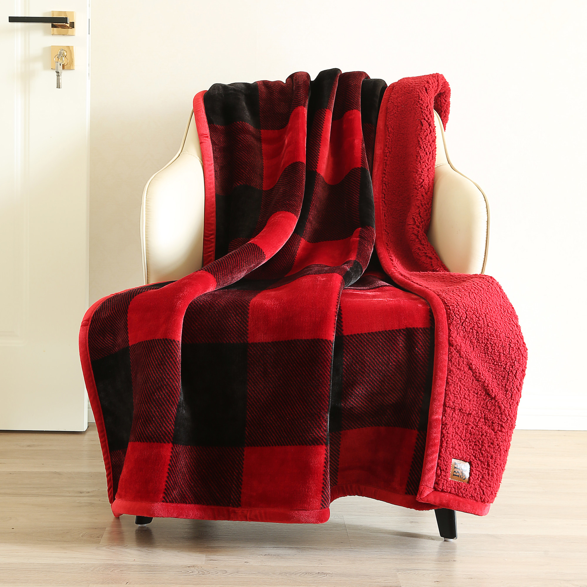 The red checkered throw draped over a chair to show its texture