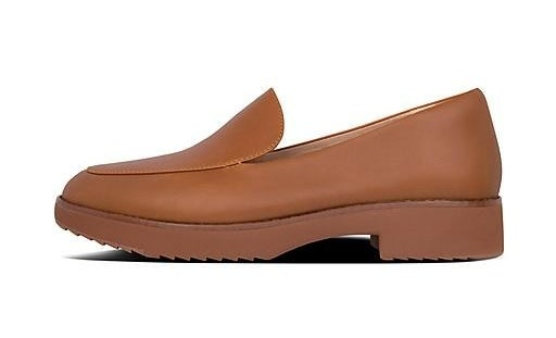 A profile view of a brown leather loafer with a chunky, grooved rubber sole