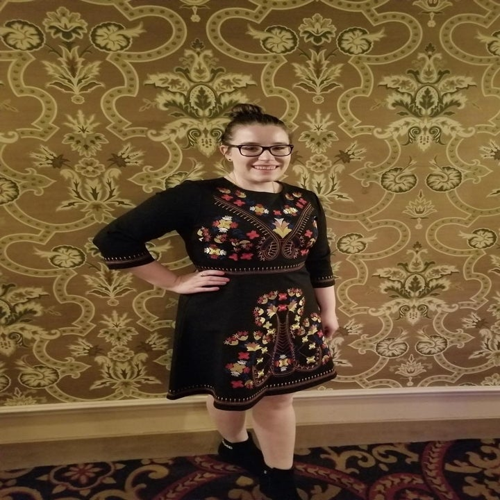 A reviewer wearing the dress with booties