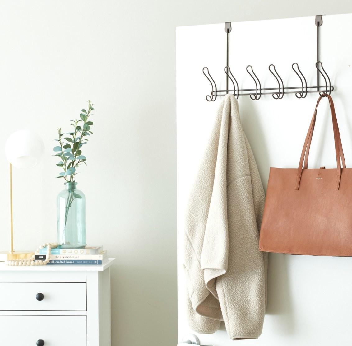 The over-the-door coat rack in bronze