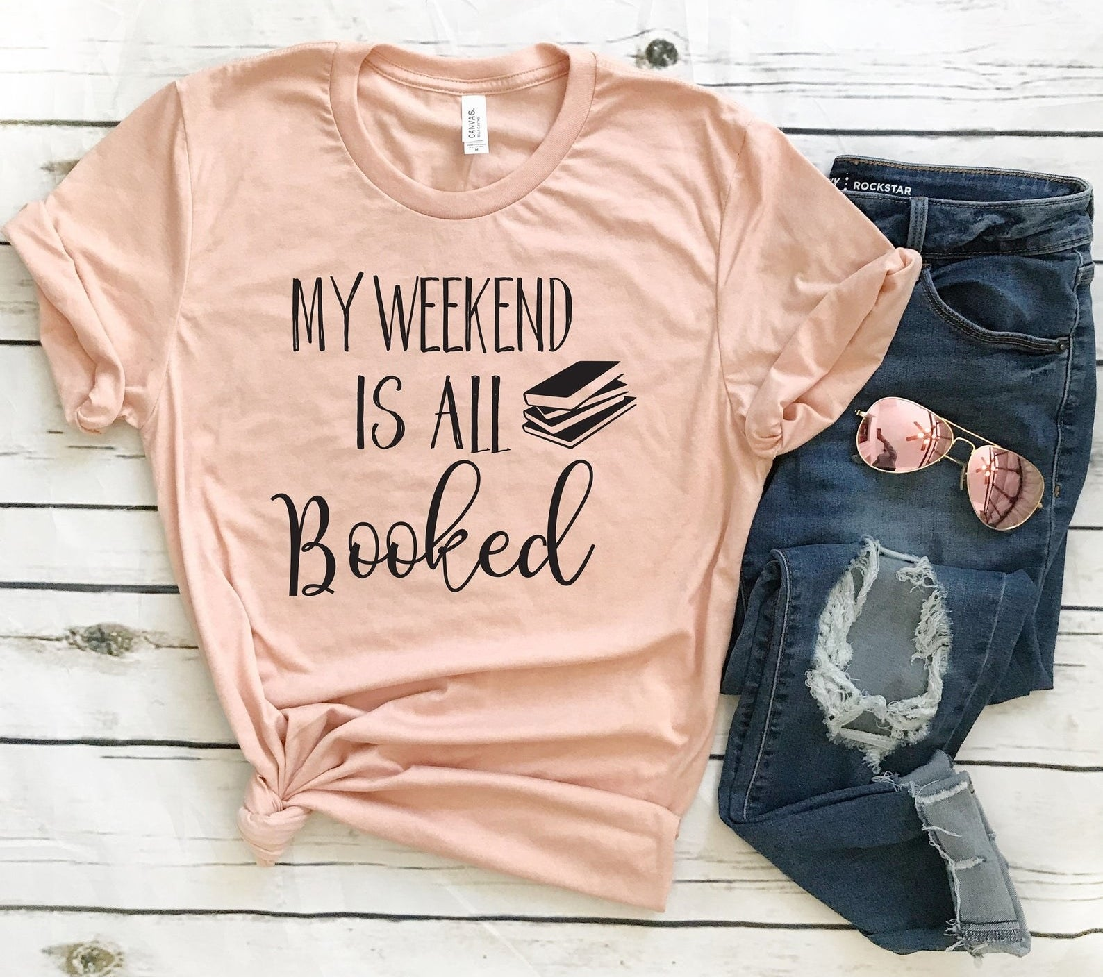 """the tee in pink that reads """"my weekend is all booked"""""""