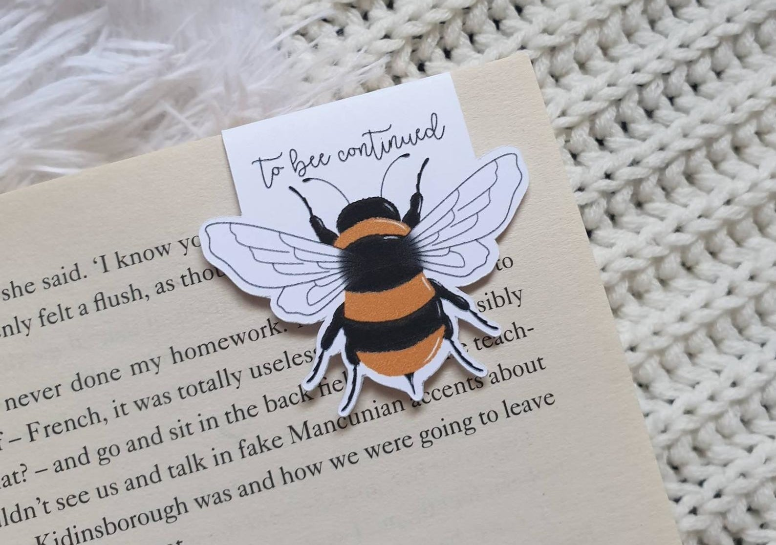 "the magnetic bee bookmark that reads ""to bee continued"""