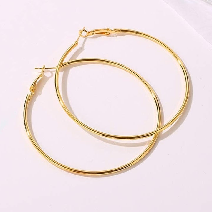Gold hoop earrings stacked on top of each other