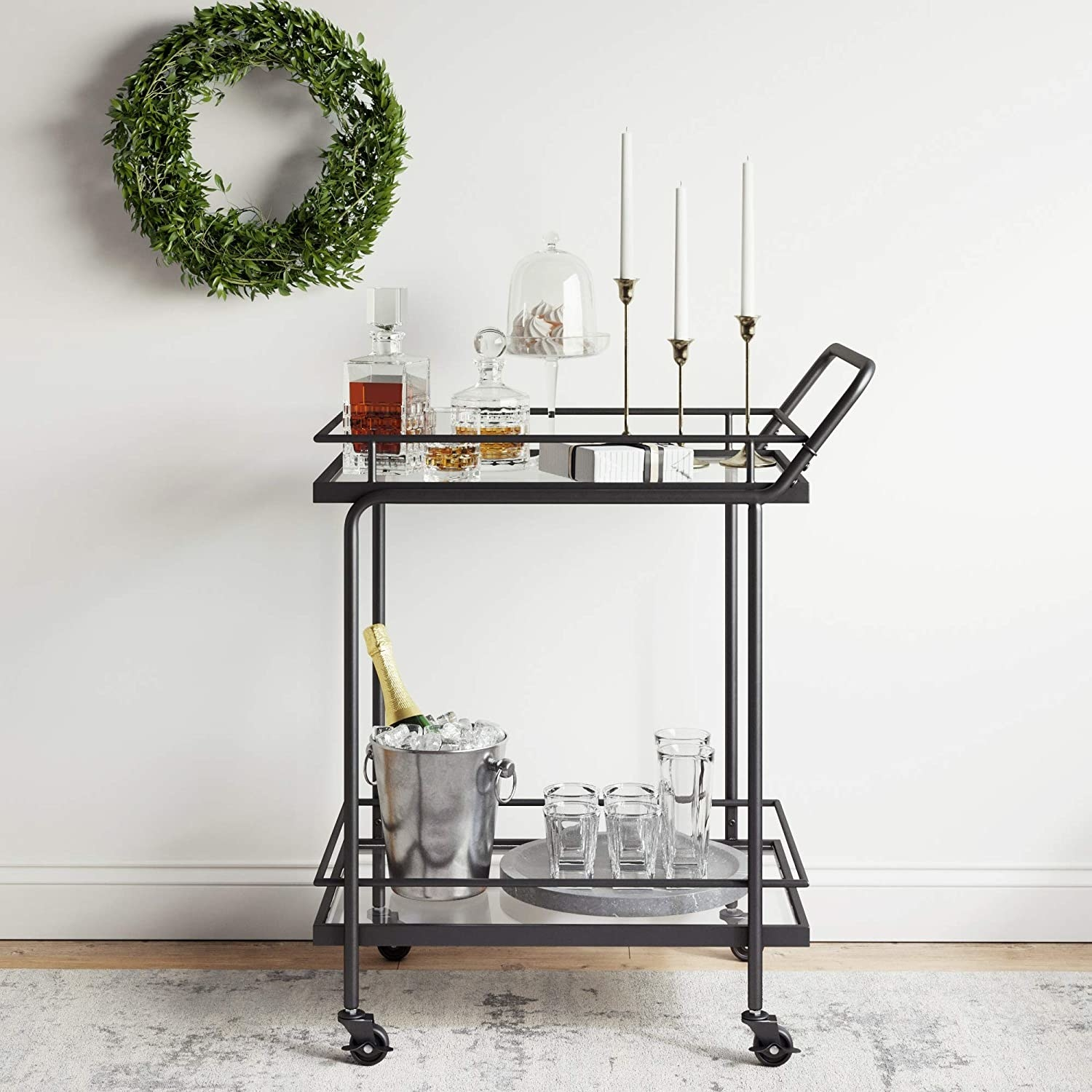 The two shelf black and glass cart