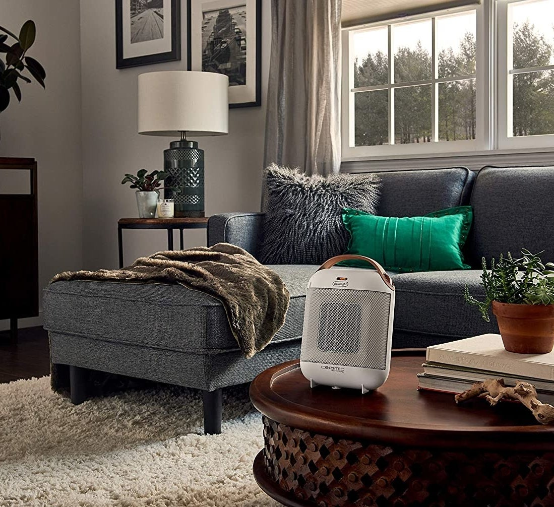 A small and elegant space heater on a coffee table