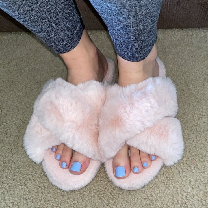 Reviewer wearing slippers in the shade pink